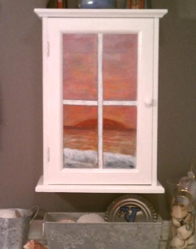 cabinet door window with ocean view