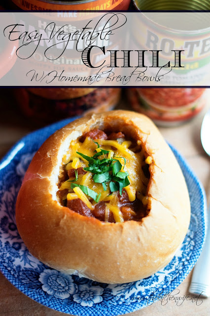 The finished chili, in the bread bowl, with the title above it.