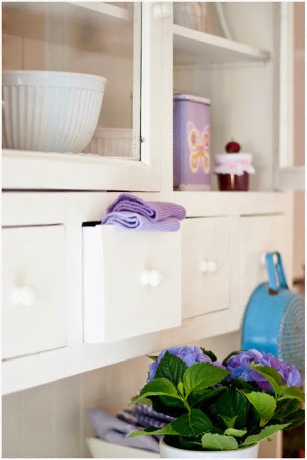 purple dish cloths in dresser