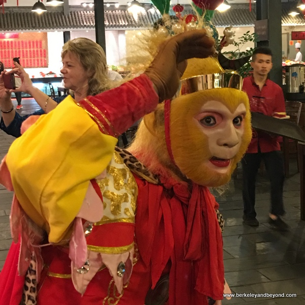 everyone wants a photo of the Monkey King at Tian Yi Jiao Restaurant in Wenzhou, China