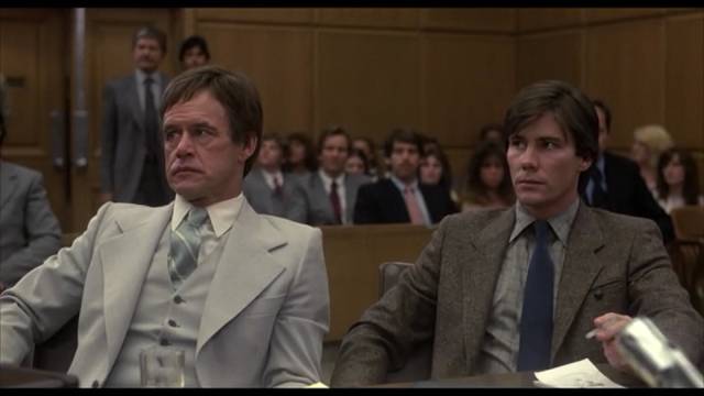 Criminal defense attorney Dave Dante (Geoffrey Lewis) and Warren Stacy (Gene Davis) in the court room in 10 TO MIDNIGHT (1983)