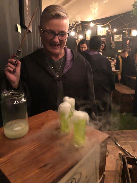 madmumof7 mixing potions with her magic wand at The Cauldron, London