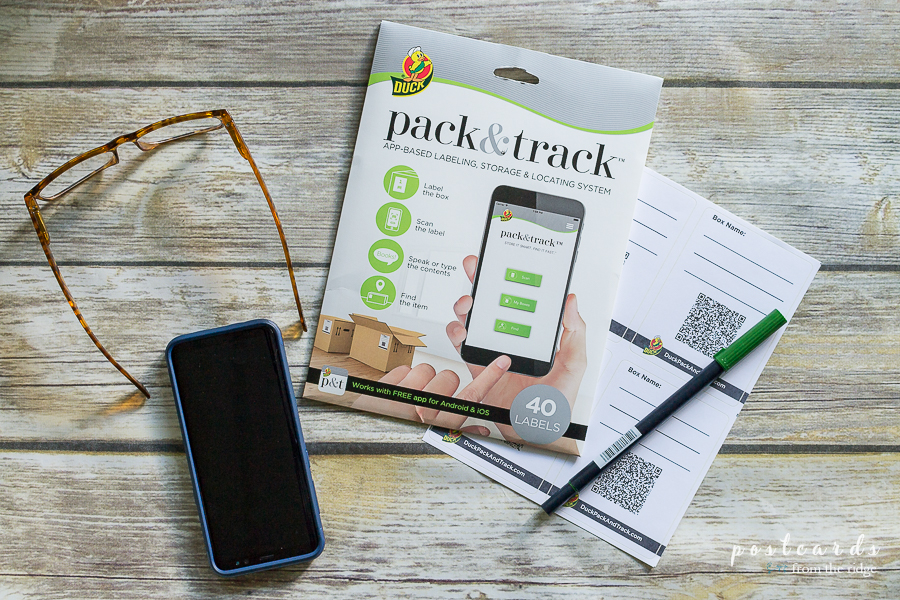 Duck Pack and Track labels with pen, phone, and a pair of glasses