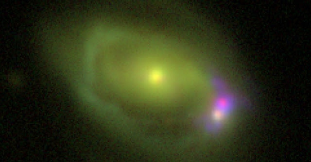 "This optical image shows the Was 49 system, which consists of a large disk galaxy, Was 49a, merging with a much smaller ""dwarf"" galaxy Was 49b. Image Credit: DCT/NRL"