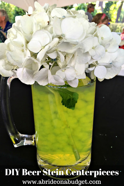 If you're having a wedding at a brewery, or just love beer, you'll love these DIY beer stein wedding centerpieces from www.abrideonabudget.com.