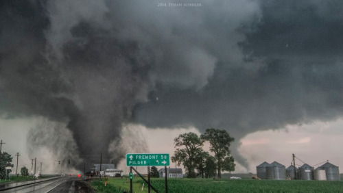 Massive storm clouds and powerful twin tornadoes