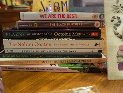 Unstoppable Octabia May by Sharon Flake, The Beautiful Struggle by Ta-Nehisi Coates, Hope in the Dark by Rebecca Solnit, Diving Into the Wreck by Adrienne Rich, Squirrel Girl Beats Up the Marvel Universe