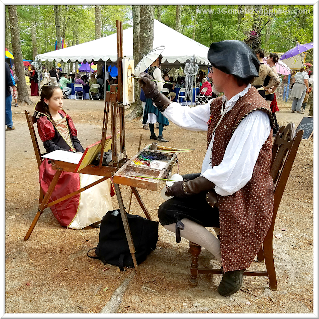 Sitting for a Portrait Painting at King Richard's Faire  |  3 Garnets & 2 Sapphires