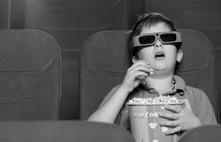 Kid at movie theater.