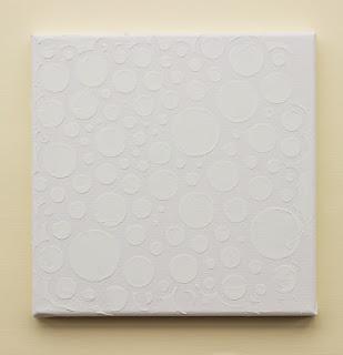 Applying texture paste using stencils onto canvas