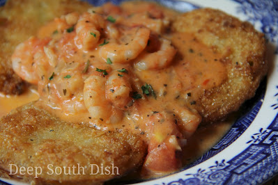 Fried green tomatoes, topped with shrimp in a fresh tomato basil cream sauce.
