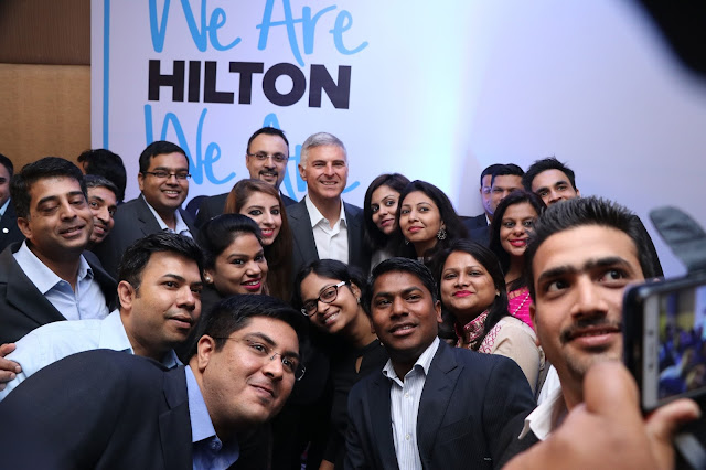 Hilton President & Chief Executive Officer Chris Nassetta taking a group photo with Team Members in India