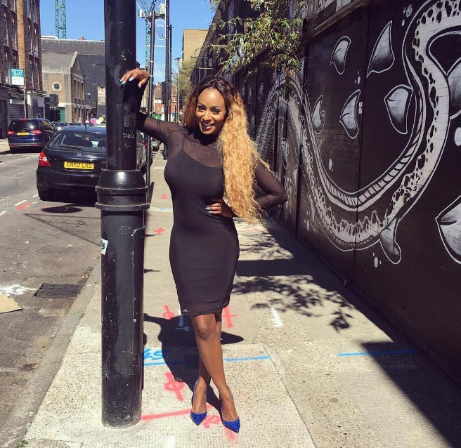 DJ Cuppy all smiles as she steps out in London