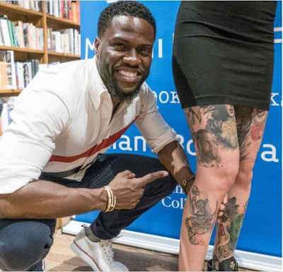 Kevin Hart poses with female fan who inked his face on her thigh