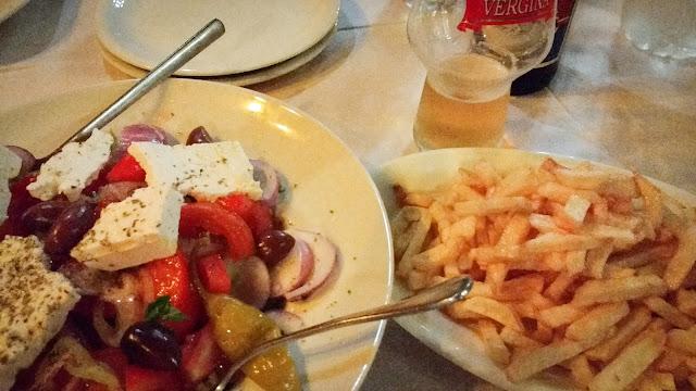 Greek salad, fries, and beer; Orestiada