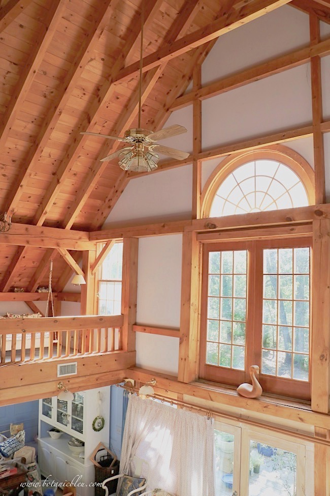 Indoor swing loft looks out large second story palladian window