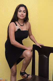 Vrushali Gosavi in strapless Short Black Dress At Follow Follow U Audio Launch 042.JPG