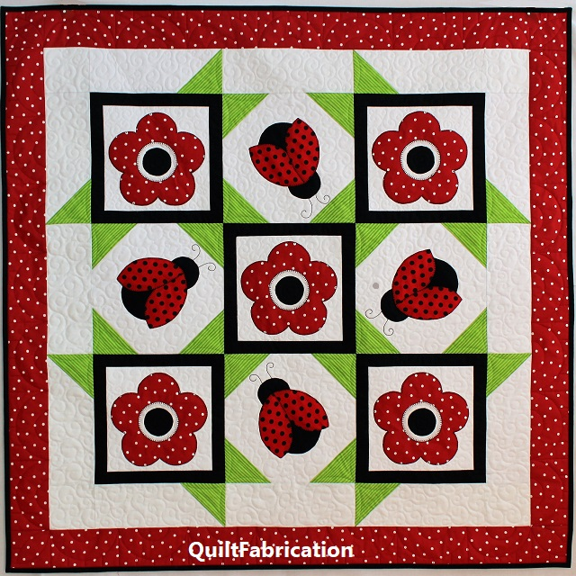 Ladybug Dance quilt by QuiltFabrication