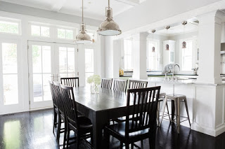 Black stained farm table and chairs in #modernfarmhouse dining room with stainless industrial pendants