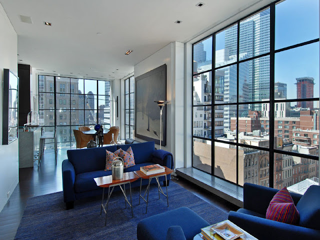Awesome Penthouse Apartment for Sale in Sweden Awesome Penthouse Apartment for Sale in Sweden small living room penthouse design with glass window white interior color decorating ideas blue fabric sofa with pillow plus carpet tiles tray table and city view
