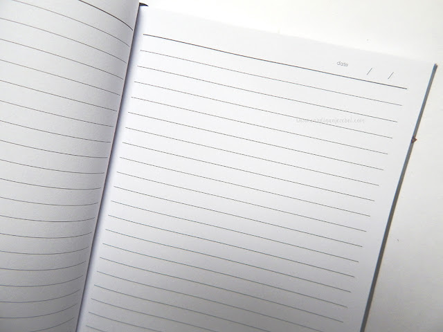Interior shot of notebook showing blank lined paper