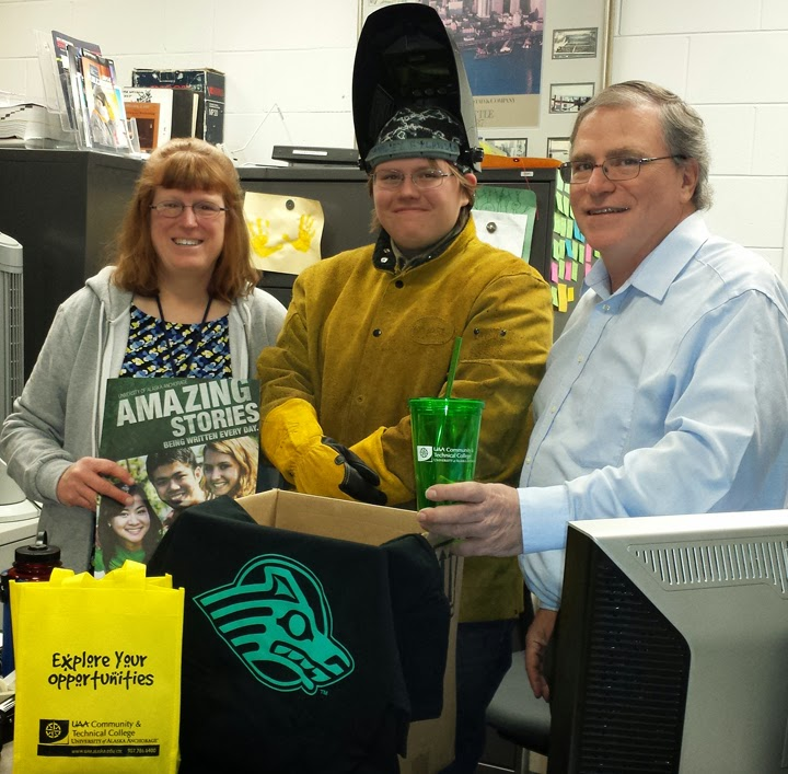 Welding faculty and staff members along with a student helped put together a goodie box for Angel. From L to R: Christine Van Valkenburg, Ashley Rylander and Kelly Smith