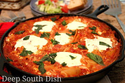 A quick skillet version of lasagna made with ground beef and sausage, diced tomatoes, tomato paste, cottage cheese, mozzarella and broken lasagna noodles. All the terrific flavor of baked lasagna, without all the time and effort.