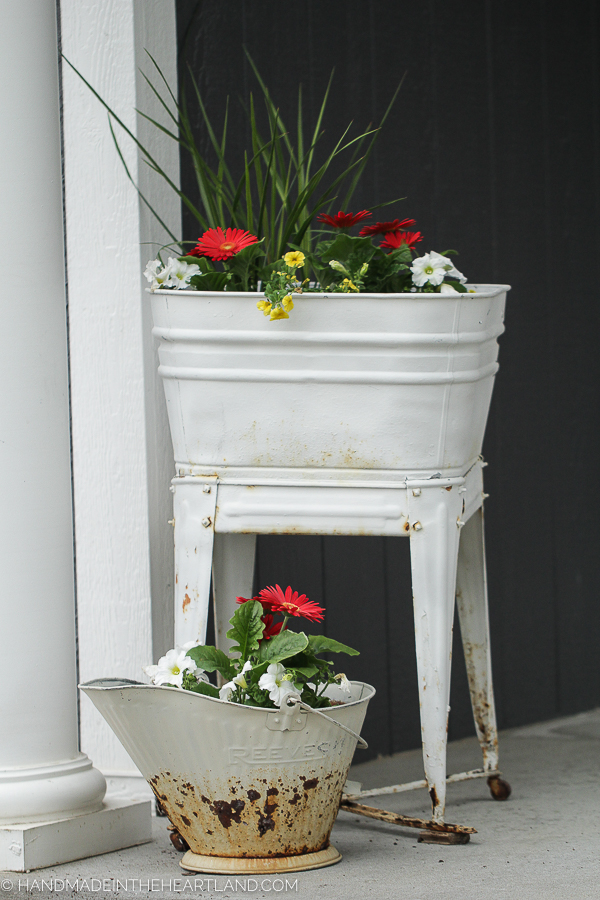 Front porch flower pots in vintage metal containers