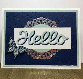 This navy and sky card uses Stampin' Up!'s Papillon Potpourri and Vertical Garden stamp sets.  We also used the Elegant Butterfly Punch, Fluttering embossing folder, and Metallic Foil Doilies.  #stampinup #stamptherapist www.stampwithjennifer.blogspot.com