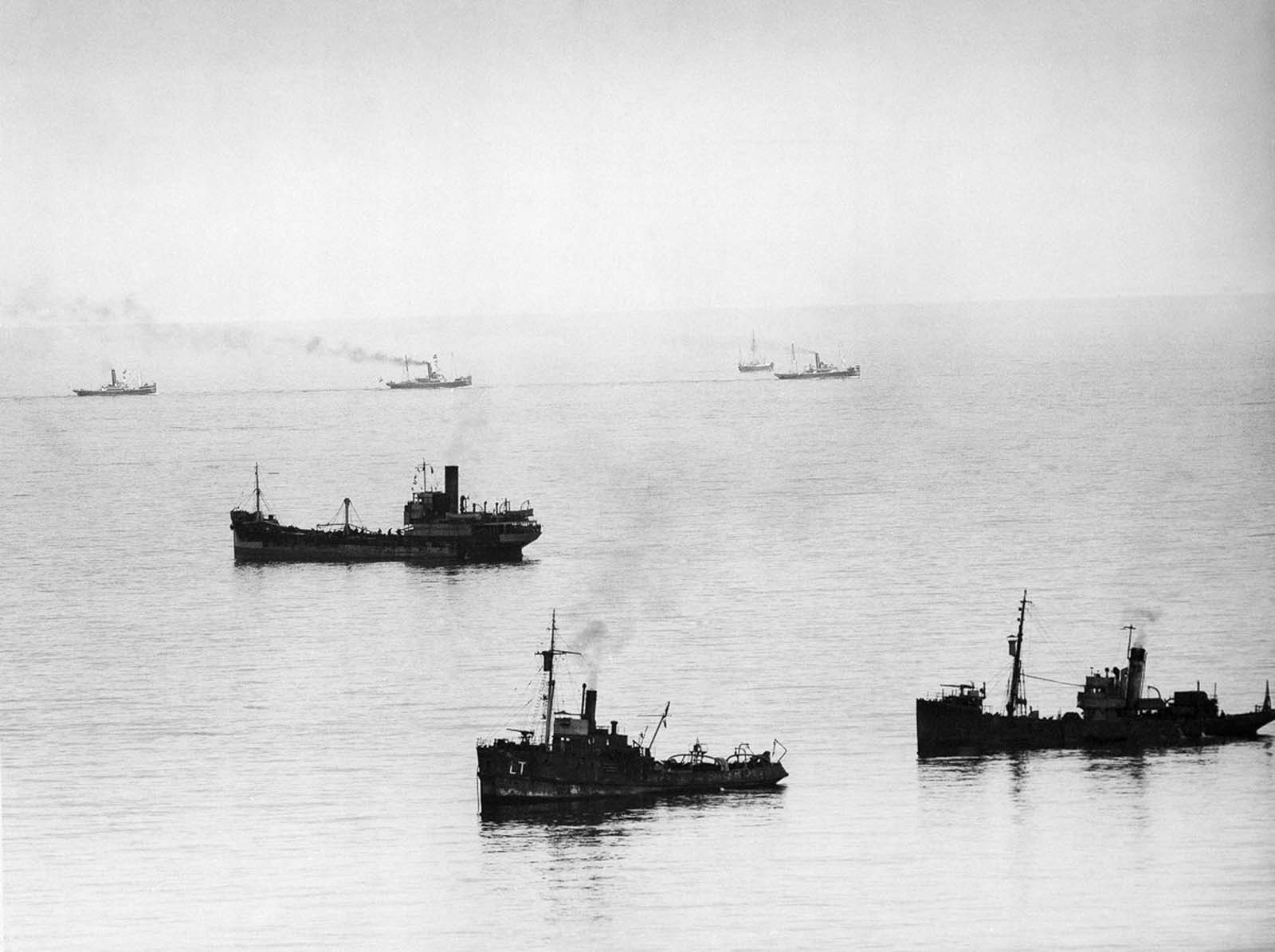 Allied minesweepers work to clear the English Channel while a convoy of evacuation ships head for Dunkirk.