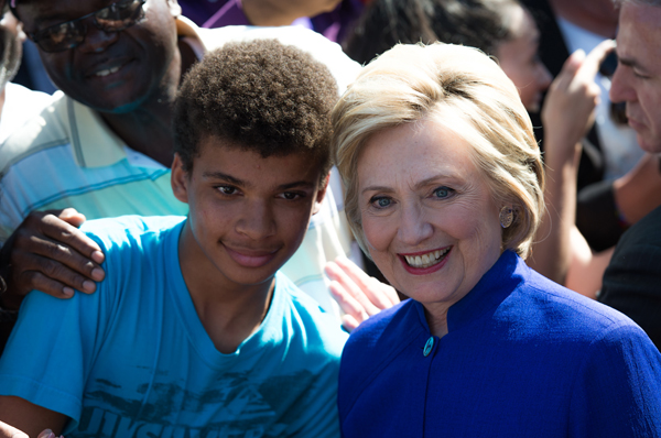 image of a Black teenage boy taking a selfie with Hillary