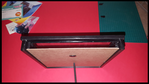 Cutting out the top section of a box frame to make a memory box