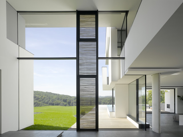 Photo of glass wall of an amazing home as seen from the interior
