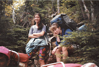 Color photo of two female students out in the woods on Trips in 1992