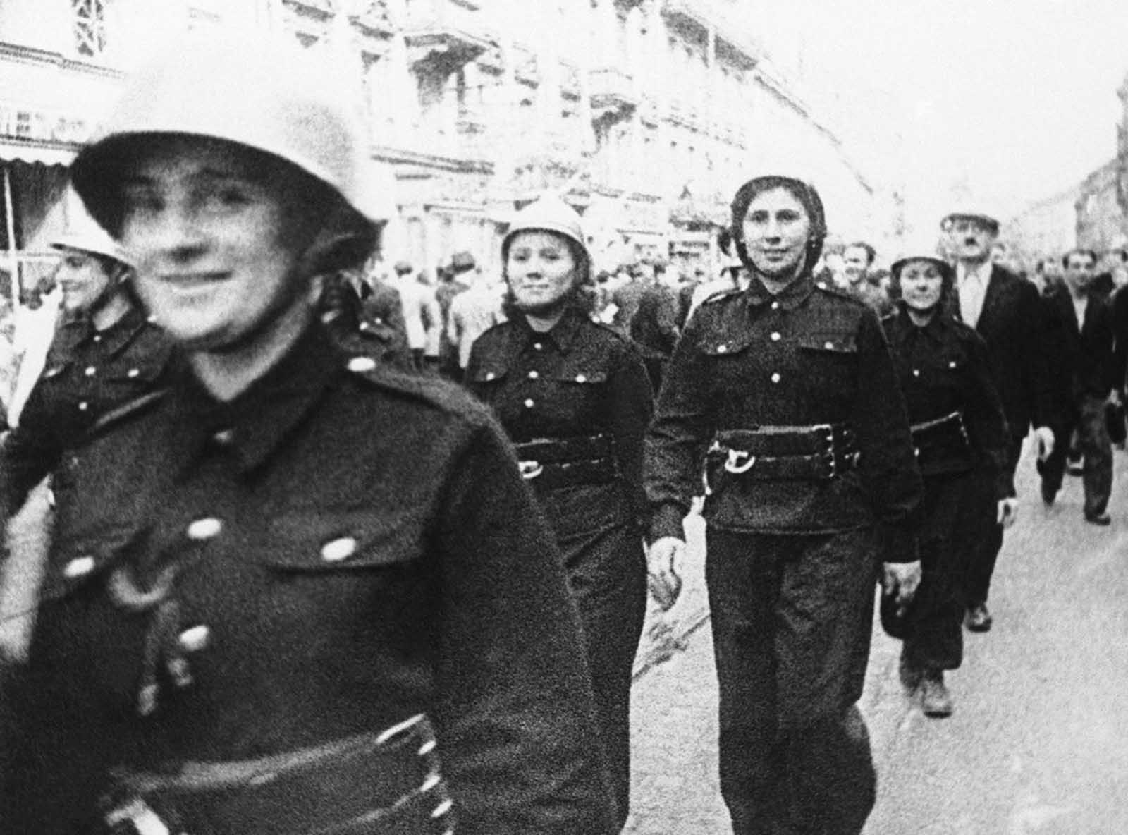 Steel-helmeted, uniformed Polish women march through the streets of Warsaw to aid in defense of their capital after German troops had started their invasion of Poland, on September 16, 1939.