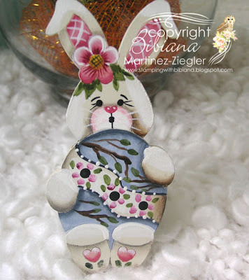 easter bunny pin holding an egg