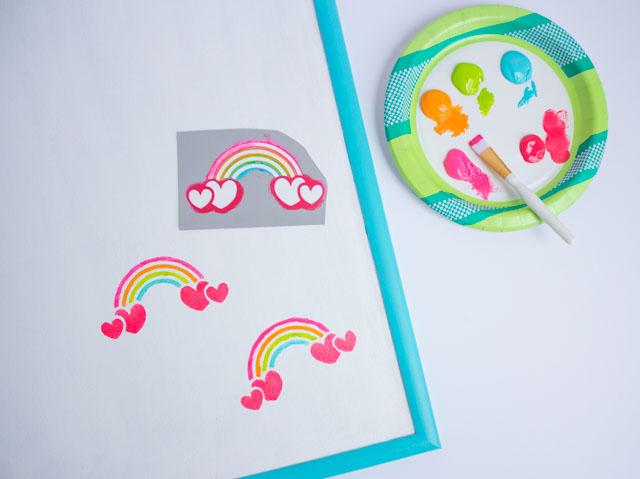 Update a cork board with rainbow stencils! #corkboard #rainbowdecor #kidsdecor