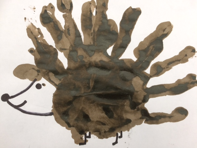 Hedgehog painting made with a handprint