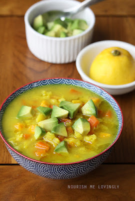 Vegetable soup with avocado and lemon