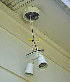 Electric Work Installing Outdoor Flood Lights Under The Eaves