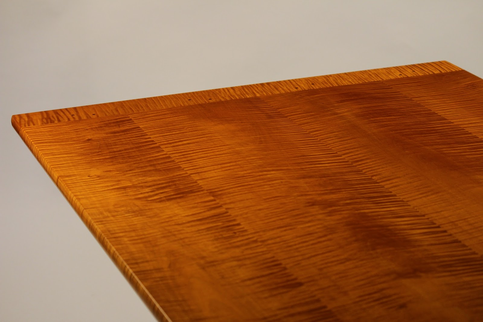 curly maple table top with breadboard ends