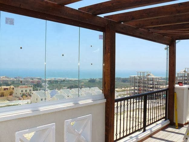 Terrazas cerradas con cristal cerramientos de cristal for Cerramientos de cristal para terrazas