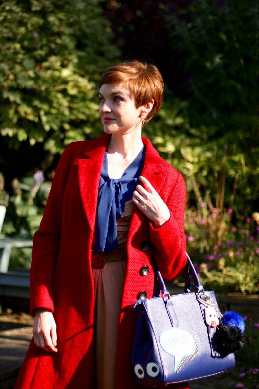 Wearing a red coat with blue.