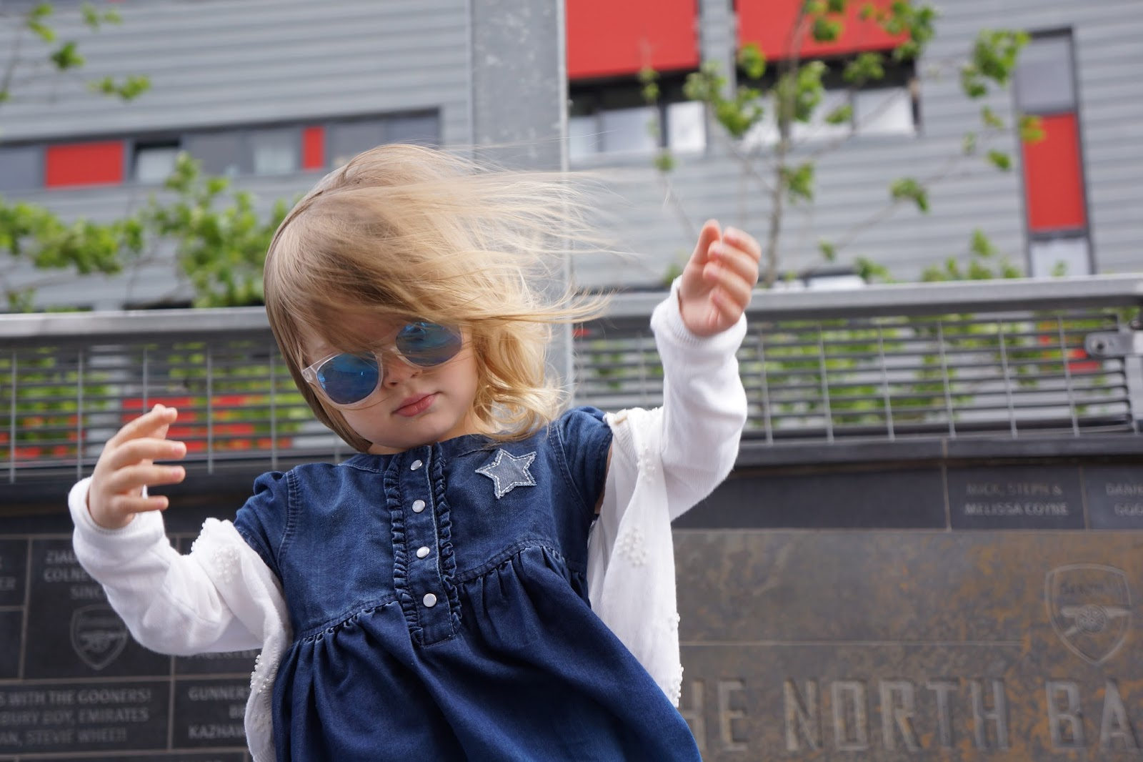 toddler wearing blue reflective sunglasses