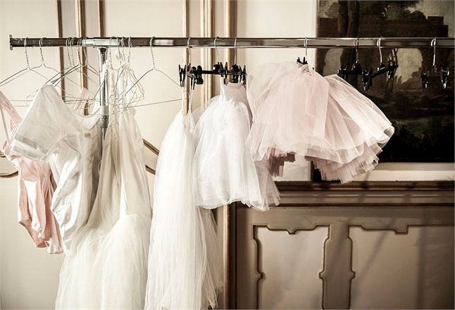 Tutus and ballet costumes hanging from bar Vogue Italy seen on Hello Lovely