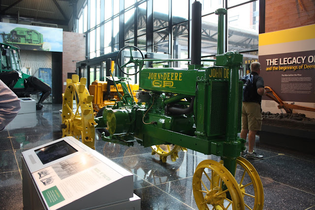 An early John Deere tractor at the John Deere Pavilion