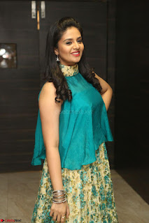 Anchor Srimukhi in green sleeveless top and skirt at O Pilla Nee Valla Movie Audio Launch Feb 2017 098.JPG