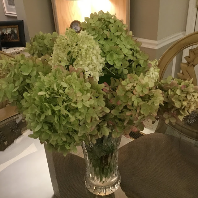 white hydrangeas in a crystal vase