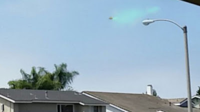 Silver UFO over US could be damaged spraying fuel everywhere.