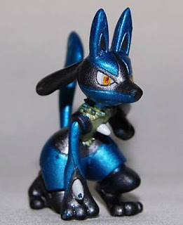Lucario figure crouching pose metallic version in Shougakukan Magazine 2005 promo